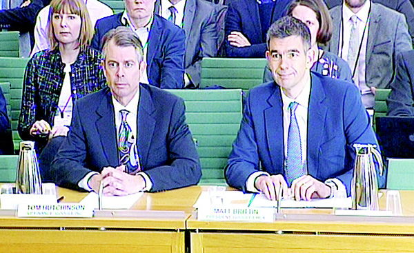 In this image made from a video, Google Vice-President Tom Hutchinson (left), and President of Google Europe, Middle East and Africa, Matt Brittin, give evidence to the British government Commons Public Accounts Committee in London, on Feb 11. The executives are appearing before the government committee following controversial agreements over tax payments by the internet giant.(AP)
