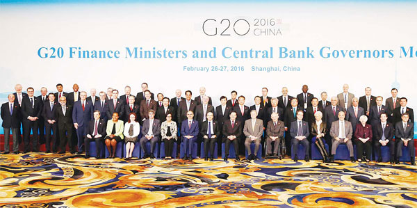 Officials led by host country officials Chinese Finance Minister Lou Jiwei (center left in front) and People's Bank of China Governor Zhou Xiaochuan, (center right in front) pose for a family photo of G20 Finance Ministers and Central Bank Governors Meeting at the Pudong Shangri-la Hotel in Shanghai, on Feb 27. (AP)