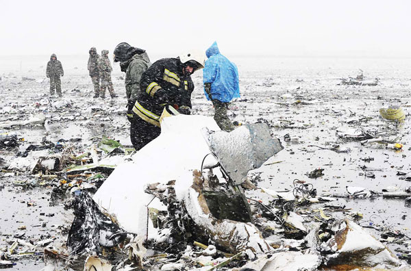 Russian Emergency Ministry employees investigate the wreckage of a crashed plane at the Rostov-on-Don airport, about 950 kms (600 miles) south of Moscow, Russia on March 19. (AP)