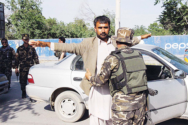 Afghan security personnel search commuters at a checkpoint in Kunduz province on April 15. Afghan security forces drove Taleban fighters back from Kunduz city, officials said, as the insurgents began the 2016 fighting season by targeting the northeastern provincial capital they briefly captured last year. (AFP)