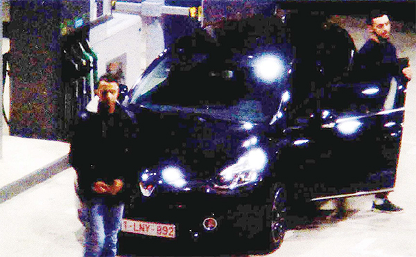 This file video image taken from a CCTV camera at a petrol station in Ressons, north of Paris on Nov 11, 2015 shows Salah Abdeslam (left), a suspect in the Paris attack of Nov 13, and Mohammed Abrini (right), coming out of the Renault Clio car which was used in the attacks two days later. Paris attacks suspect Mohammed Abrini was arrested on April 8, according to police sources. (AFP)