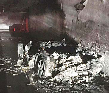 the completely destroyed car of the wanted criminal