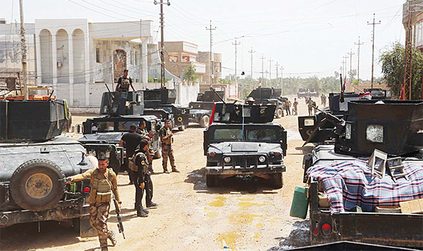 Iraq's elite counterterrorism forces advance their positions during fight between Iraqi security forces and Islamic State group during a military operation to regain control of Hit, 85 miles (140 kms) west of Baghdad, Iraq on April 13. (AP)