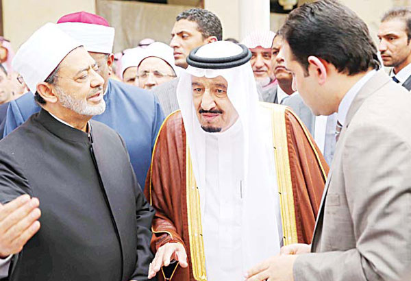 A handout picture made available by Al-Azhar media center on April 9 shows the Grand Imam of al-Azhar Sheikh Ahmed Al-Tayeb (left), and Saudi King Salman bin Abdulaziz Al-Saud (center), visiting the mosque at Al-Azhar headquarters, the most prestigious institution in Sunni Islam in the Egyptian capital Cairo. (AFP