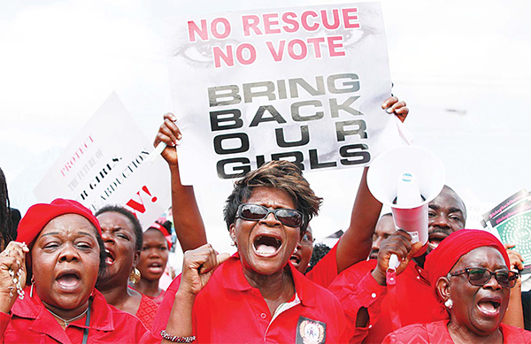 In this May 5, 2014 file photo, women attend a demonstration in Lagos calling on the government to rescue kidnapped school girls of a government secondary school in Chibok, Nigeria.