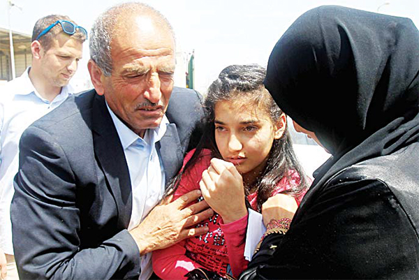 The parents of Palestinian Dima al-Wawi, 12, who is believed to be the youngest female detained by Israel