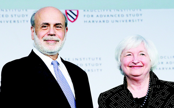 Federal Reserve Chair Janet Yellen (right), poses with her predecessor Ben Bernanke while being introduced during a Radcliffe Day event at Harvard University in Cambridge, Massachusetts, on May 27. (AP)