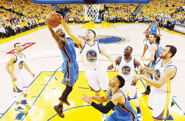 Klay Thompson #11 of the Golden State Warriors blocks a shot by Serge Ibaka #9 of the Oklahoma City Thunder during game two of the Western Conference Finals during the 2016 NBA Playoffs at ORACLE Arena on May 18, in Oakland, California. (AFP)