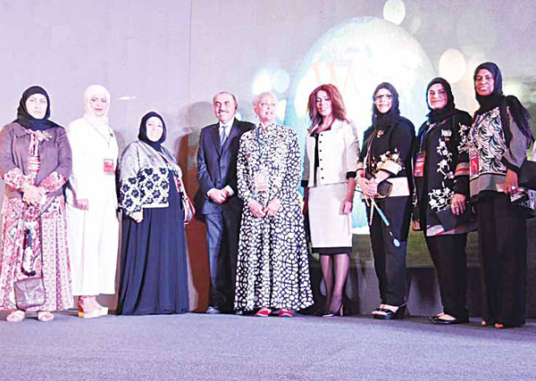 Sheikha Hessa poses with other participants at the forum.