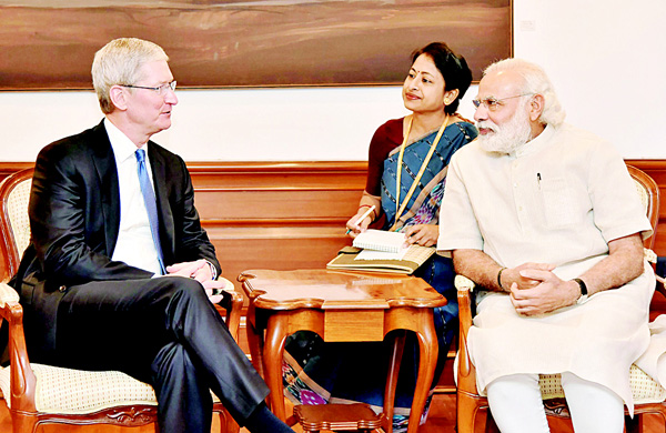 In this handout photograph released by The Indian Press Information Bureau (PIB) on May 21, Indian Prime Minister Narendra Modi (right), speaks with Apple CEO Tim Cook during a meeting in New Delhi on May 21. Apple chief executive Tim Cook met with Prime Minister Narendra Modi in New Delhi, launching a new version of the Indian leader's eponymous app on a visit aimed at pushing the technology giant's expansion plans. Cook, shown in a video using the premier's gold-coloured iPhone, launched an update to the Narendra Modi Mobile App to include a new volunteering network, the government said. (AFP)