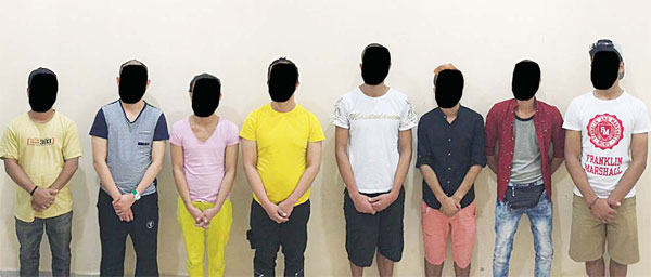 The illegal expats arrested in a massage parlour.
