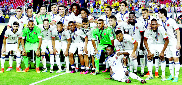 Colombia soccer players pose for a photo after their Copa America Centenario third-place soccer match win against the United States, June 25, in Glendale, Arizona. (AP)