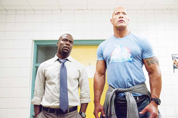 This image released by Warner Bros Entertainment shows Kevin Hart (left), and Dwayne Johnson in a scene from 'Central Intelligence'. The movie had a relatively muscular weekend, with a better-than-expected $34.5 million, according to comScore estimates on June 19. (AP)
