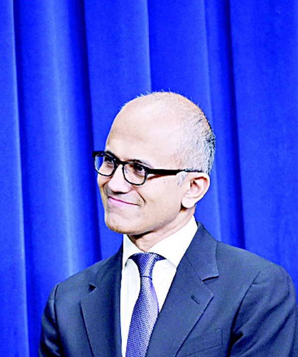 This file photo shows Microsoft CEO Satya Nadella as he watches US President Barack Obama deliver remarks at the Eisenhower Executive Office Building in Washington, DC. Microsoft said June 13, it signed a deal to acquire the professional social network LinkedIn for $26.2 billion in cash. 'The LinkedIn team has grown a fantastic business centered on connecting the world's professionals,' Microsoft chief executive Satya Nadella said. (AFP)