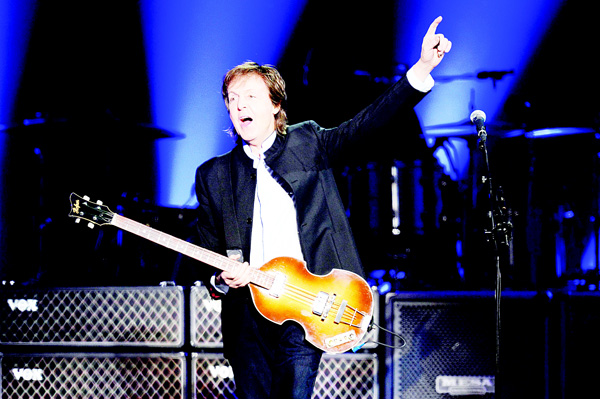British musician and former Beatles' member Paul McCartney performs on stage at the Bercy Stadium in Paris on May 30. (AFP)