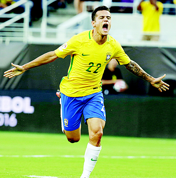 Brazil's Philippe Coutinho (22) celebrates after scoring a goal against Haiti during the first half of a Copa America Group B soccer match on June 8, in Orlando, Florida. (AP)