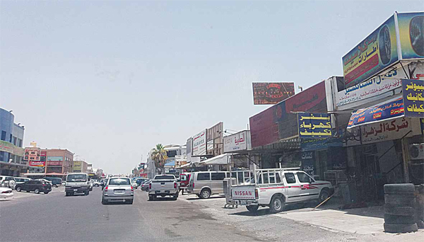 Picture taken in Shuwaikh Industrial Area. Potholes, broken pavements, garbage and traffic congestion are some of the maladies facing Shuwaikh Industrial Area