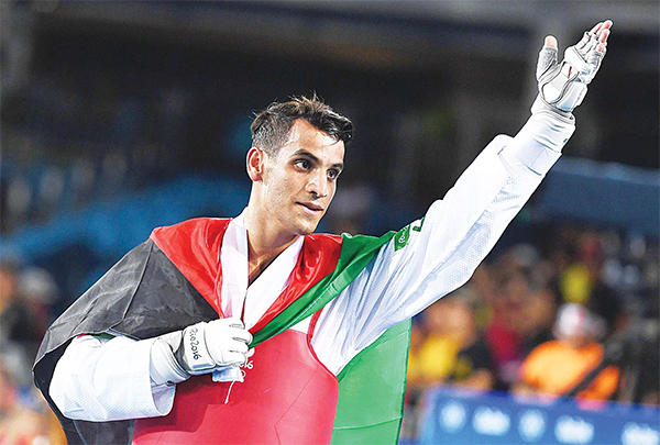 Jordan's Ahmad Abughaush celebrates after winning against Russia's Alexey Denisenko in the men's taekwondo gold medal bout in the -68kg category as part of the Rio 2016 Olympic Games, on Aug 18, at the Carioca Arena 3, in Rio de Janeiro. (AFP)