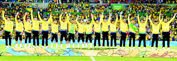 Brazil's forward Neymar (center), and teammates celebrate on the podium during the medal presentation following the Rio 2016 Olympic Games men's football gold medal match between Brazil and Germany at the Maracana Stadium in Rio de Janeiro on Aug 20. Neymar struck the winning penalty as Brazil claimed a first ever Olympic football gold medal with victory over Germany at the Maracana on Saturday. (AFP)