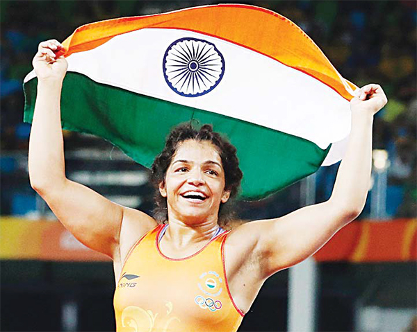India's Sakshi Malik celebrates after winning against Kirghyzstan's Aisuluu Tynybekova in their women's 58kg freestyle bronze medal match on Aug 17, during the wrestling event of the Rio 2016 Olympic Games at the Carioca Arena 2 in Rio de Janeiro. (AFP)