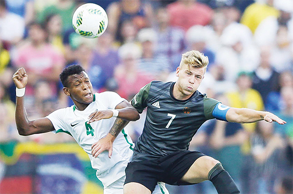 Nigeria's Abdullahi Shehu (left), and Germany's Maximilian Meyer vie for the ball during a semifinal match of the men's Olympic football tournament between Germany and Nigeria in Sao Paulo, on Aug 17. (AP)