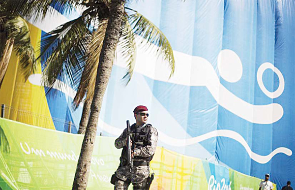 A National Security Force officer patrols outside the beach volleyball arena along Copacabana Beach ahead of the upcoming 2016 Summer Olympics in Rio de Janeiro, Brazil on Aug 2. (AP)