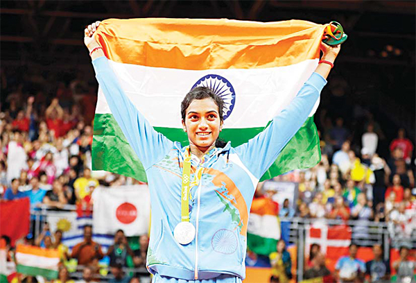 India's Pusarla V. Sindhu wears her silver medal during the medal ceremony for women's badminton singles at the 2016 Summer Olympics in Rio de Janeiro, Brazil on Aug 19. (AP)