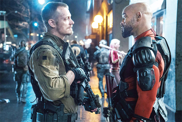This image released by Warner Bros Pictures shows, Joel Kinnaman, (left), and Will Smith in a scene from 'Suicide Squad.' (AP)