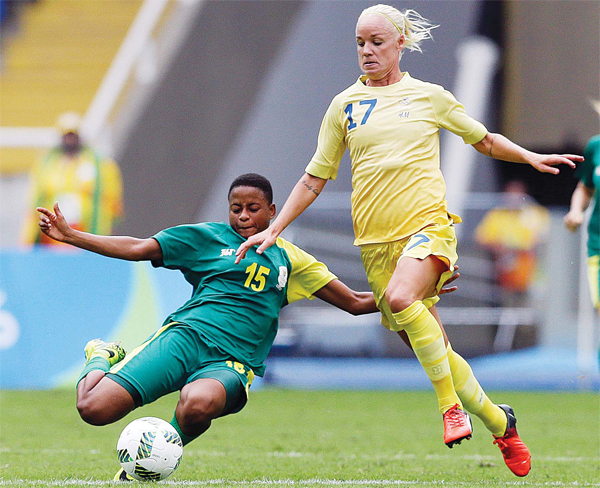 Sweden's Caroline Seager (right), and South Africa's Refiloe Jane fight for the ball during the opening match of the Women's Olympic Football Tournament between Sweden and South Africa at the Rio Olympic Stadium in Rio de Janeiro, Brazil, on Aug 3. (AP)