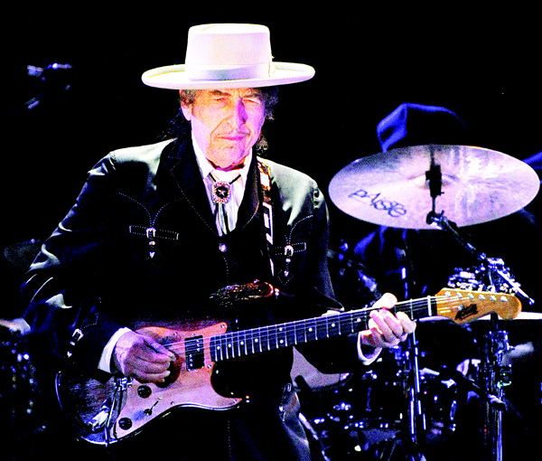 This file photo taken on April 25, 2011 shows US poet and folk singer Bob Dylan performing during the Bluesfest music festival near Byron Bay. (AFP)