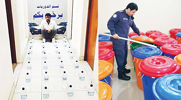 Left: The Asian with 28 bottles and a police offi cer inspects barrels of liquor (right