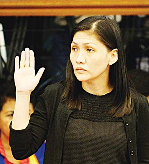 Rizal Commercial Banking Corp (RCBC) branch manager Maia Santos- Deguito takes an oath during a senate hearing in Manila on March 15. A Philippine bank said it is investigating an $81 million deposit after Bangladesh accused Chinese hackers of stealing from a US account and illegally moving the funds online to the Philippines and Sri Lanka. (AFP)